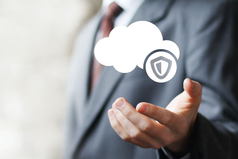 Businessman pushing button cloud protection virus security shield.jpg