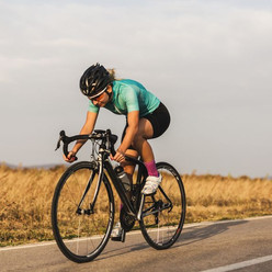 professional-female-cyclist-on-the-road-