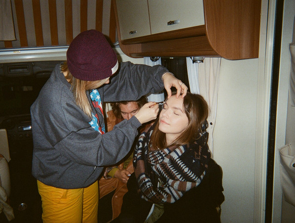 Zane is getting a make up by Mairisa. Its 5am, preparing for the opening scene.