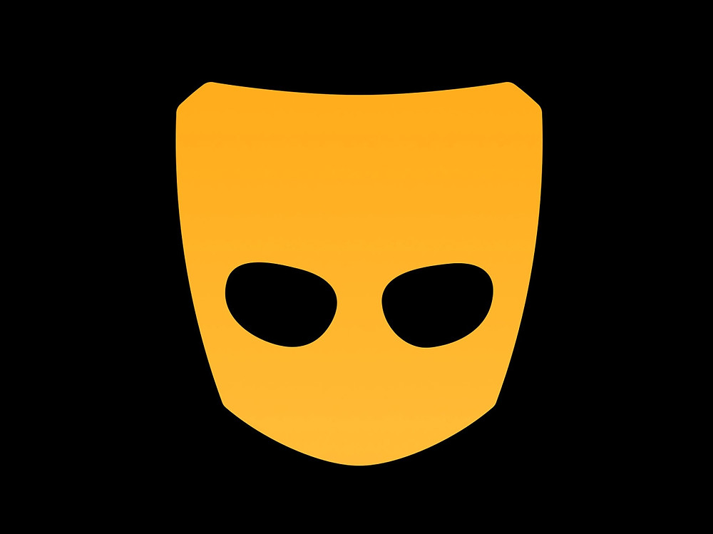 Grindr logo image yellow mask