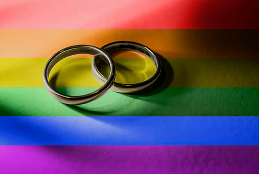 LGBTQ Flag with Same Sex Gay Wedding Rings