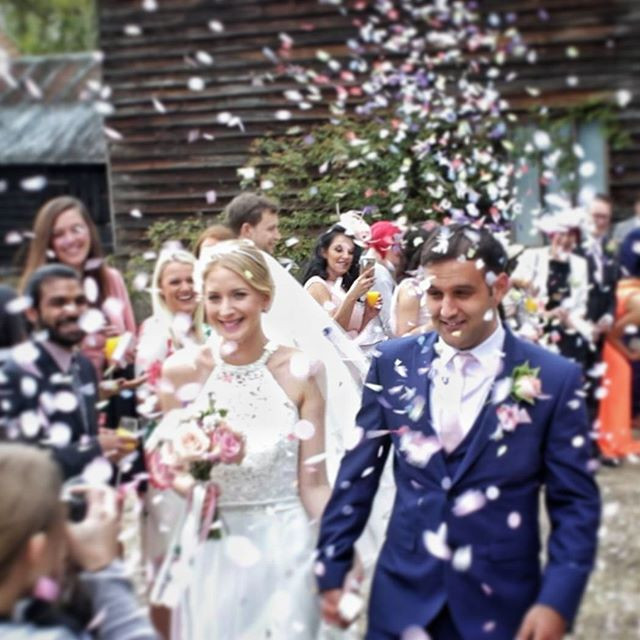 In a blizzard of confetti at Abigail & Aarron's wedding.