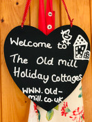 The Old Mill Holiday Cottages, welcome sign