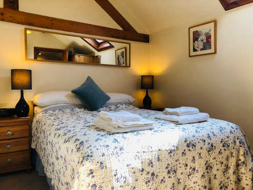 The Hayloft, double bedroom, The Old Mill Holiday Cottages