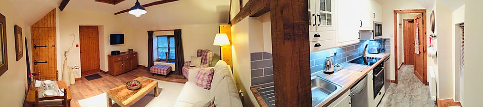 The Hayloft, Holiday Cottage, sleeps 2 people, The Old Mill Holiday Cottages North Wales.  Photo of living room and kitchen