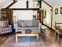 The Hayloft, Living room and dining area, The Old Mill Holiday Cottages