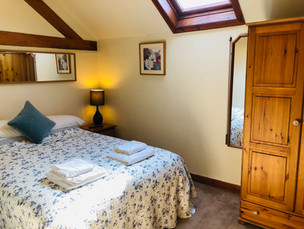 The Hayloft Double bedroom, North Wales Holiday Cottages CH7 5RH