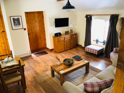 The Hayloft, Living room, The Old Mill Holiday Cottages