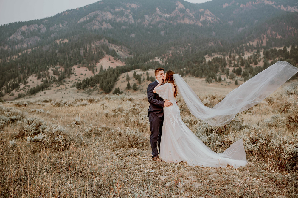 Bride and groom posing at Big Sky, Montana for their Montana wedding by Missoula Wedding Photographer and Videographer, Infinite Photography and Film. Nationally featured on Style Me Pretty.