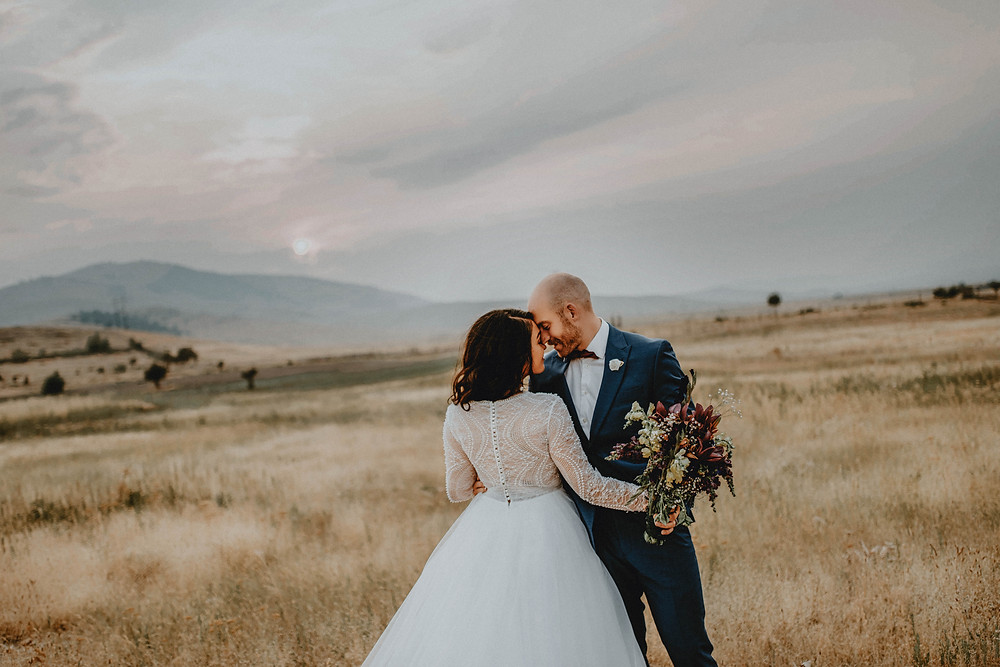 Missoula wedding photographer and videographer, Infinite Photography and Film captures a wedding on the Mission Mountains in Montana.