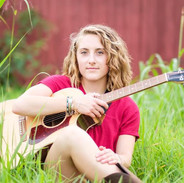 Toni Clare field and guitar.jpg