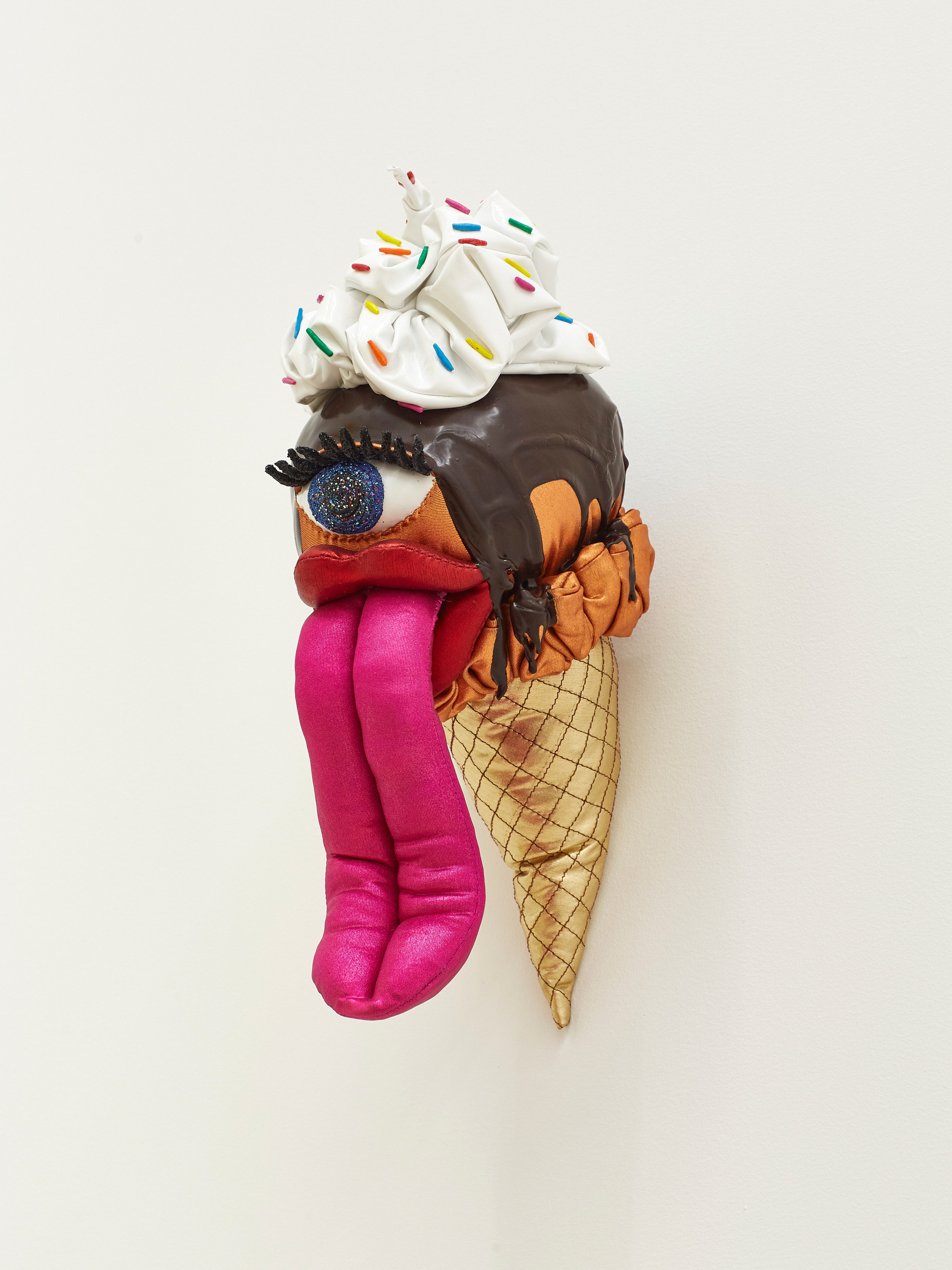 Orange with Chocolate Sauce, Whipped Cream, and Rainbow Sprinkles, 2019 Acrylic, felt, fiberfill, glitter, modeling clay, spandex, string, wire, and vinyl 11 x 5.5 x 9 inches