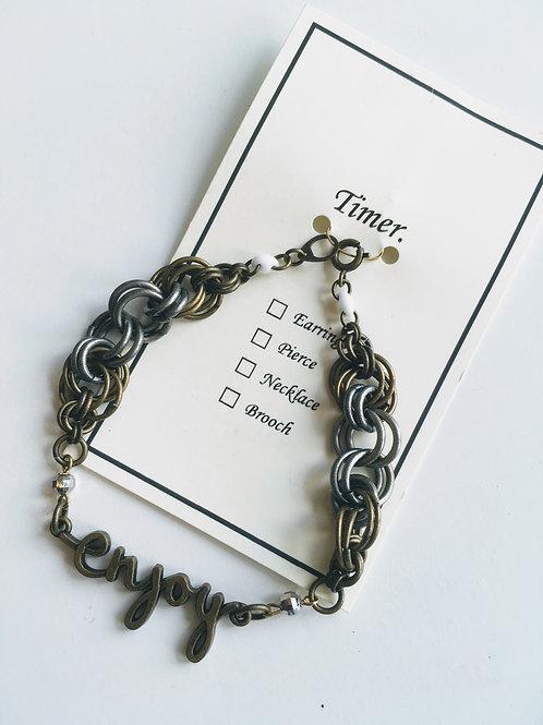 Timer.brass motif bracelet