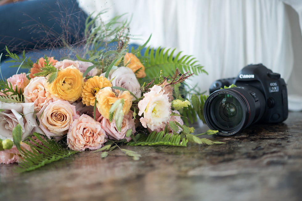 Natarsha with camera and bouquet