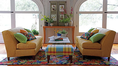 Norwalk Sofa, accent rug and ottoman in bright colorful room