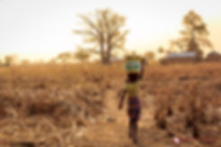 African Girl Carrying Water