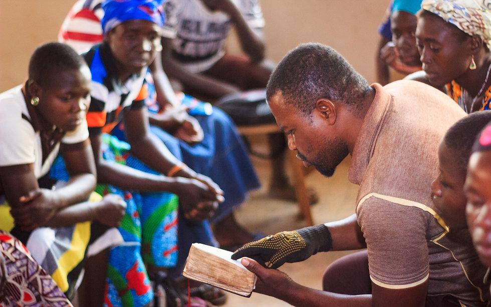 African Man Teaching Bible