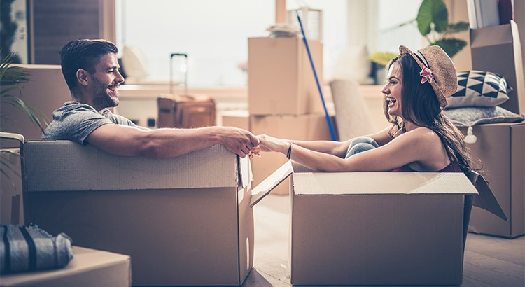 Couple having fun in moving boxes