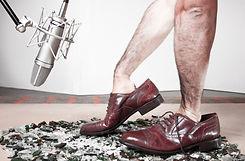 Soundman hands inside of a man's elegant
