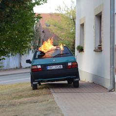 Hořící auto Nikolina Otce