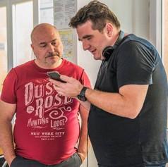 Michal David jako Školník s režisérem Janem Lengyelem