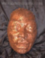 welded coin face sculpture by Marcin Gornia