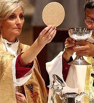 femme-prêtre-e1501679754662-960x438.jpe