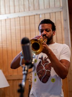 Huntertones player playing the trumpet in Vital Companies's studio