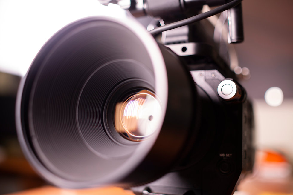 Close up of video camera lens in natural light and soft focus