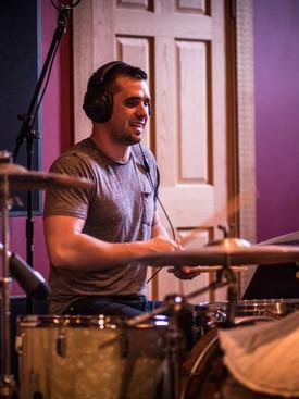 Man playing drumset in studio