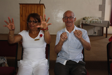 Assistant and stroke survivor enjoying the exercise group