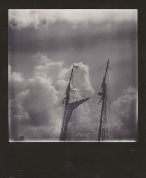 black and white polaroid of a tall ship.
