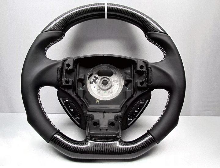 2011 Aston Martin Vantage S custom carbon fiber steering wheel