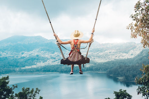 carefree-woman-swing-inspiring-landscape