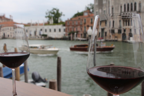 The quintessential Venetian moment - a balcony on the grand canal and a few glasses of wine to savor.