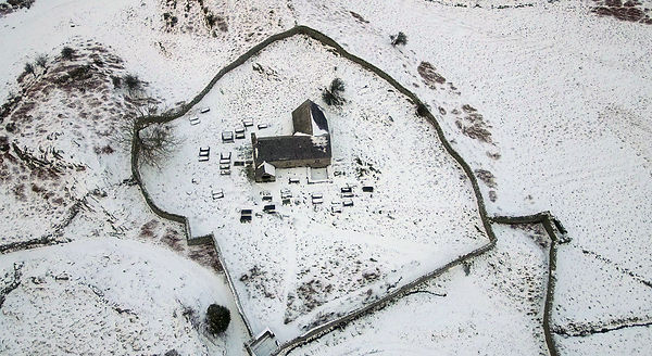 Aerial view ancient church in snow