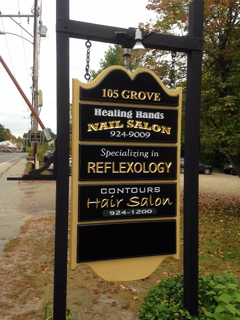 Group commercial signs, hand carved