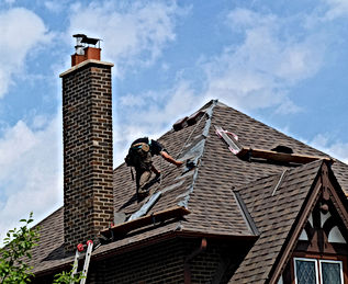 roofer at work repairing a steeply slope