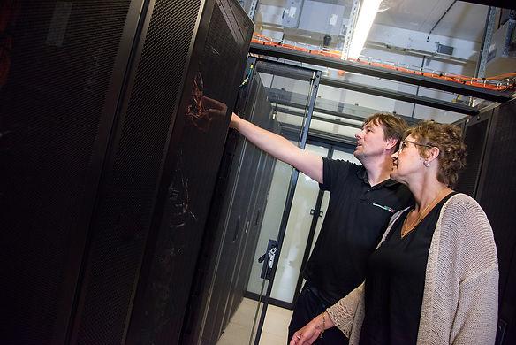VSC staff pointing at server