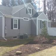 AFTER - Custom siding, trim and new fence install