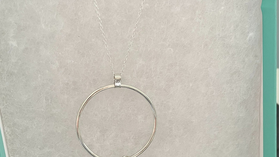 Sterling Silver circle pendant with heart detail