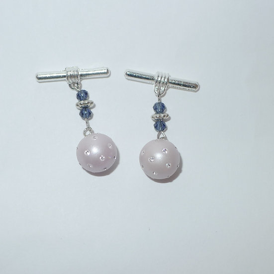 Rhodium plated sterling silver light pink frosted glass ball cufflinks for women.