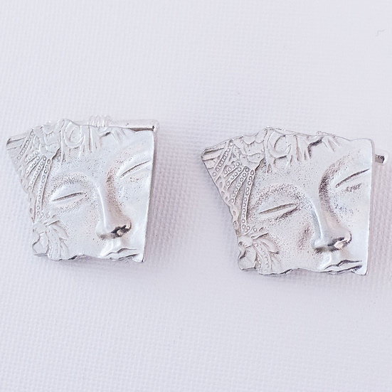 Serene, beautiful face carved in silvertoned base metal cufflinks for women.