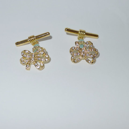 14 karat gold plated bows covered in clear crystals cufflinks for women.