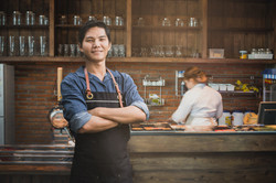 Successful small business owner standing