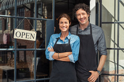 Two cheerful small business owners smili