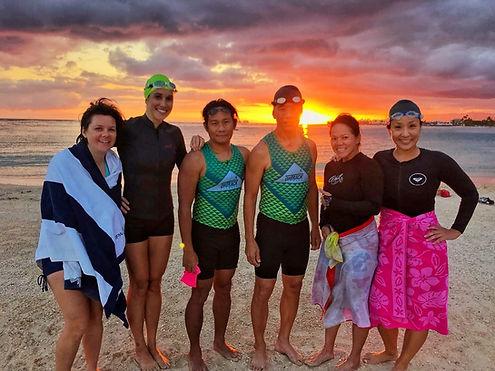 OnTrack Fitness swim team on the beach in Hawaii