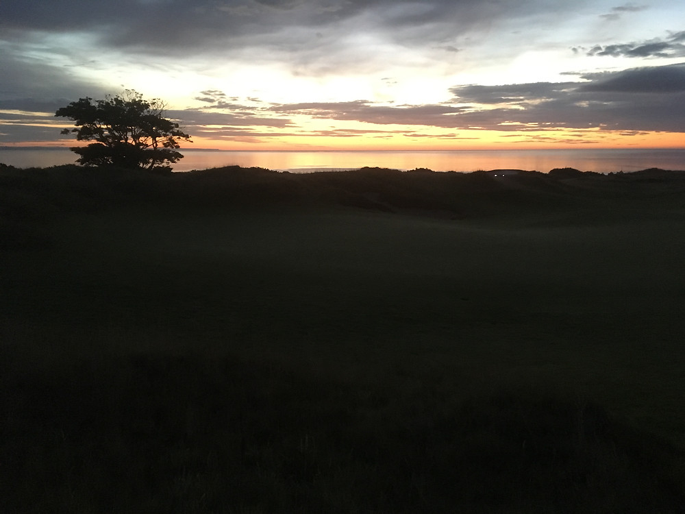 Sun rising over first green on The Castle course, St Andrews
