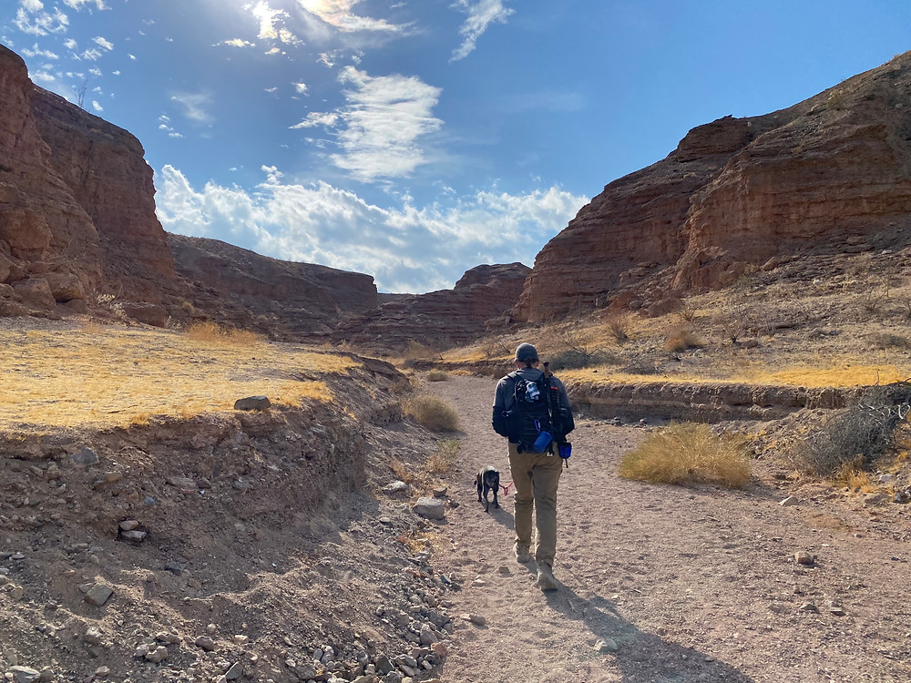 Jason and Poe hiking the trail at Owl Canyon, Lake Mead National Recreation Area, Nevada