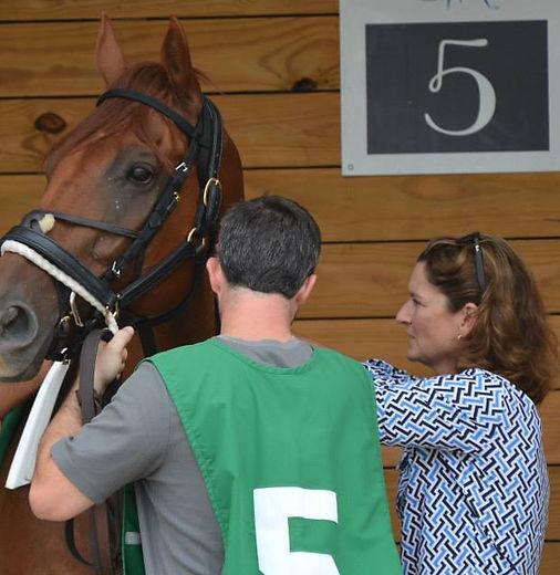 Elizabeth Merryman saddling horse